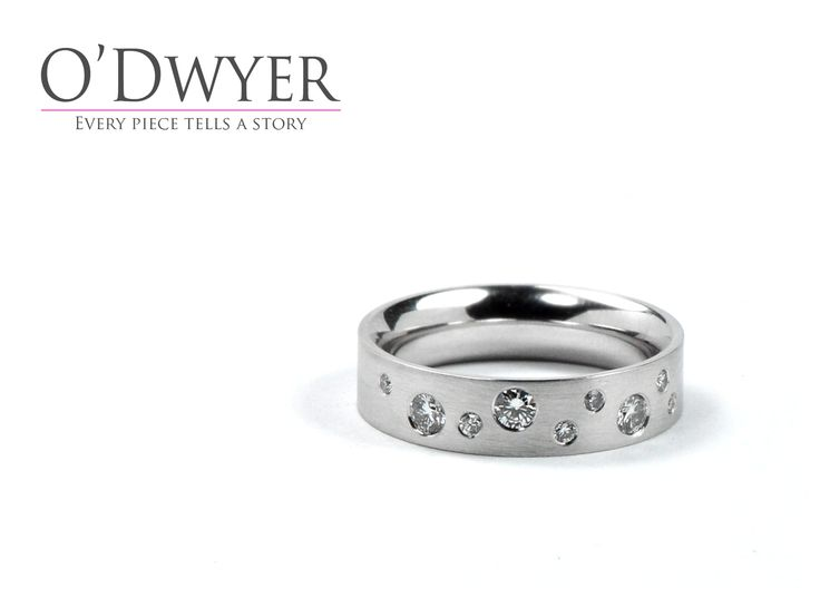 18ct white gold ring sprinkled with diamonds.