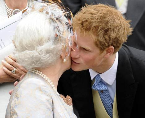 Prince Harry embracing his grandmother Queen Elizabeth II at the Peter Philips & Autumn Kelly wedding on 17th may 2008