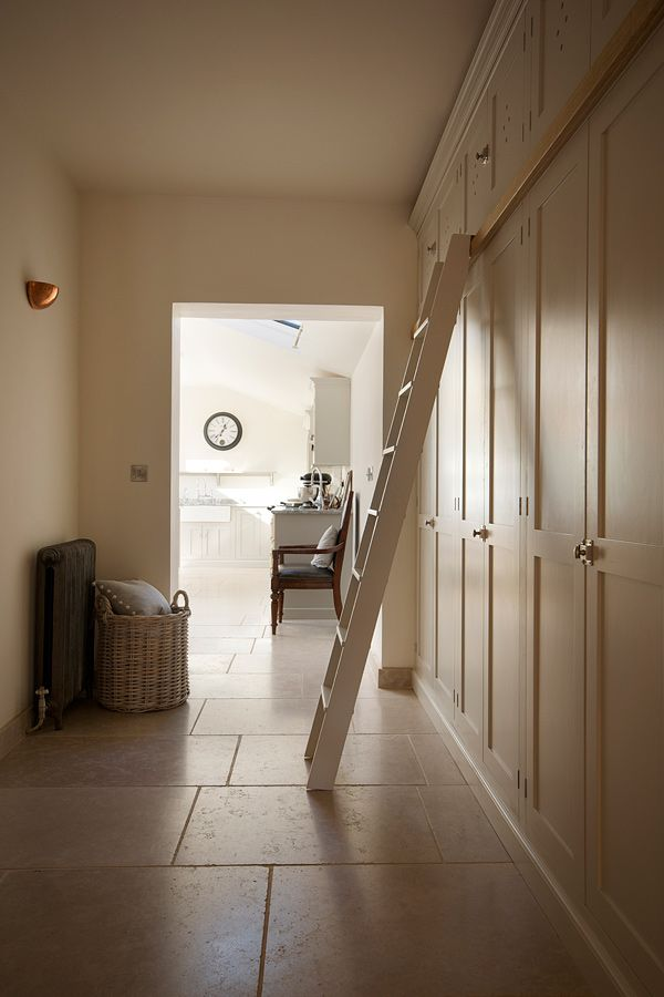 The Dijon Tumbled Limestone 600 x free-length laid in a hallway continuing through to a beautiful bright kitchen.