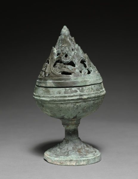 Incense Burner (Boshan Lu). 200-100 BC. China, Western Han dynasty (202 BC-AD 9). This incense burner takes the shape of the mountain to represent the mythical land of the immortals, a boundless realm filled with energy. Deities (appearing as hunters) and fantastic beasts roam freely among mists and clouds. The incense smoke coming from the burner creates a mysterious effect, as if the mountain form could attract the immortals with its sense of illusion.