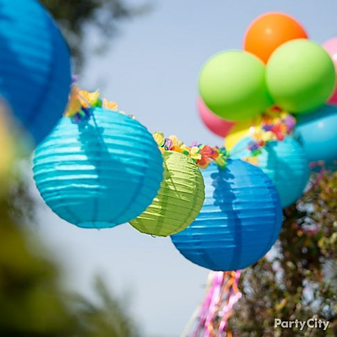 Lanterns + lei garland = easy, awesome decorating idea for a pool party or luau!