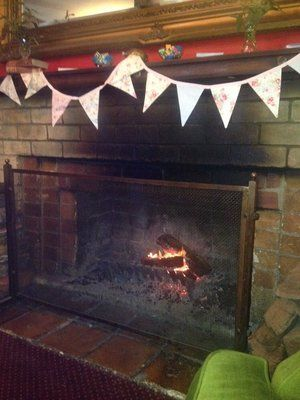 By the fire in #madameflavour's tea lounge at #10yearsofyelp hosted by Yelp Melbourne at The Kelvin Club #kettleon #bunting