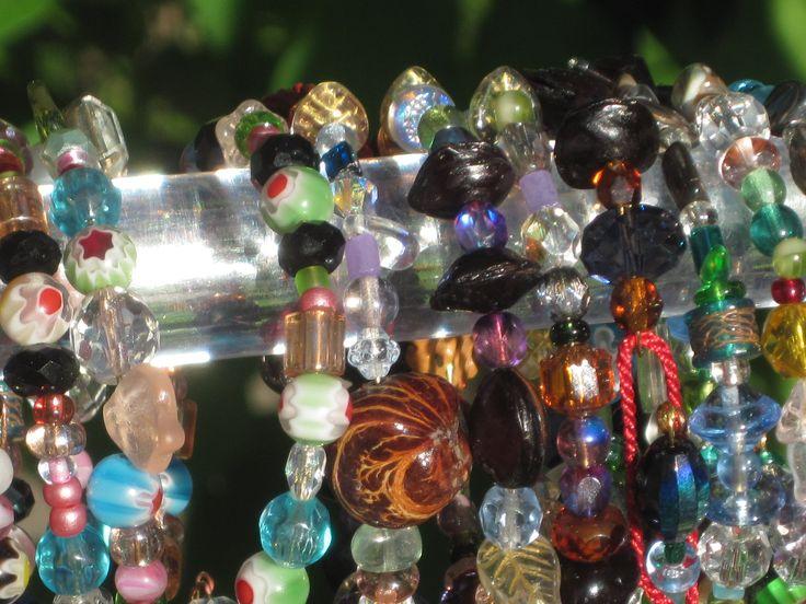 Bracelets, glass beads, charms