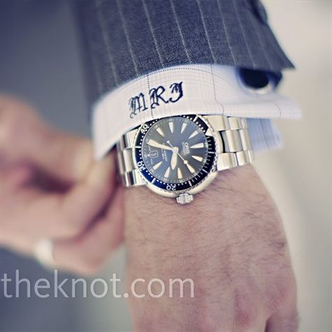 The groom wore a gray pinstripe suit with a custom-tailored shirt with monogrammed cuffs. His watch accessorized the look.
