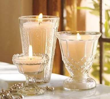 Fill a room with warmth and fragrance. Cast of glass in three eclectic profiles recalling vintage jelly jars and compote dishes, the ivory paraffin is infused with an heirloom rose scent.