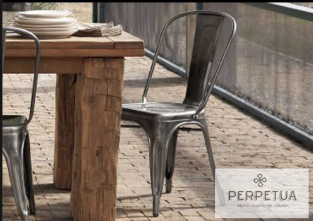 French Metal Cafe Chairs And Bulky Wood Table
