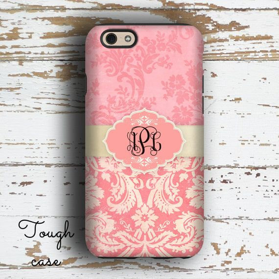This pretty monogrammed phone case has a mixture of two pink grunged up damask patterns tied together with an off white ribbon. The monogram medallion is a matching pink. This lovely Iphone or Samsung case would make the perfect personalized gift for Mom or that other favorite woman in your life who likes pretty accessories. ~~~~~~~~~~ ~♥~♥ OUR PREMIUM CASES VS OTHER STORES BUDGET CASES ~♥~♥ •Our premium monogrammed phone cases have an image that wraps over the top AND around the sides •O...