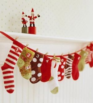 advent calendar thrifted or old christmas socks what a great idea! Wait, what about saving your kid's mismatched baby socks? What! How cute would That be?!