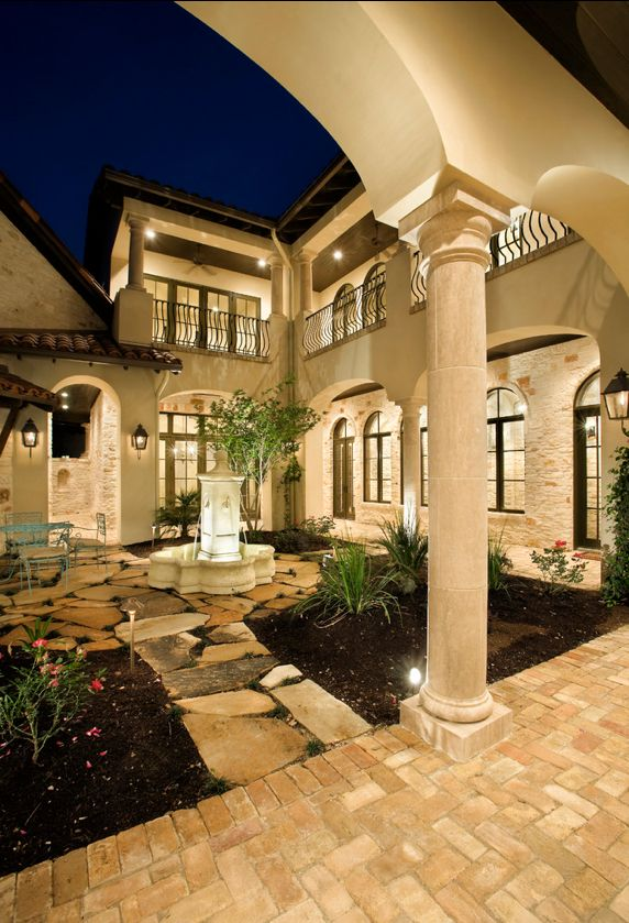 Mediterranean Tuscan Style Home. The courtyard is an extension of the interior. Love this. So welcoming!