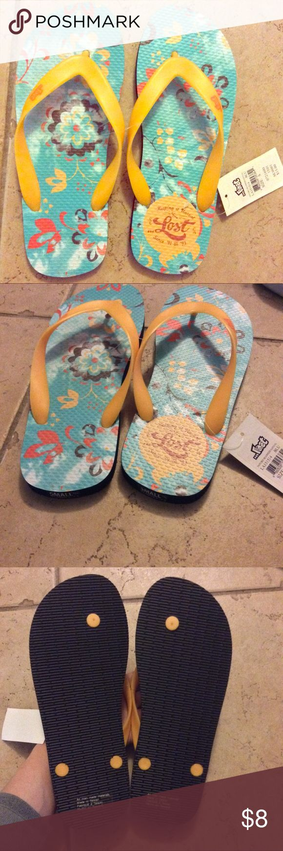 LOST Psycho Seaweed Floppers NWT  Comfy flipper floppers. Size small or a men's size 6-7.5. Thats what the tag says lol. I'm a size 7 and they're just wide all over. So for a women's size, I'd say they will fit a 7.5 Wide. LOST Shoes Sandals