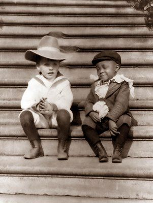 """Quentin Roosevelt, youngest son of Theodore Roosevelt, and one of his """"White House Gang"""" playmates, Roswell Pinckney, 1902. Pinckney was the son of a White House steward. The """"White House Gang"""" were known for their mischievous childhood pranks. Quentin Roosevelt later joined the Army Air Service and was killed during combat in WWI."""