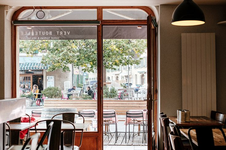 A view from inside the cosy bar looking out onto the quiet street of Vieux Carouge. Vert Bouteille wine bar Geneva.