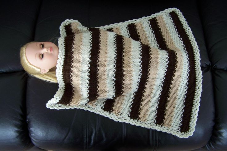 """Best Hand-knitted Doll Blanket for sale - Beautiful hand-knitted doll blanket.  It is about 46 x 46 cm and is big enough to cover dolls like American Girl.  This blanket is hand knitted from 100% acrylic yarn, it is super soft and perfect for hours of fun for little girls and their """"babies"""" Machine washable on gentle cycle."""