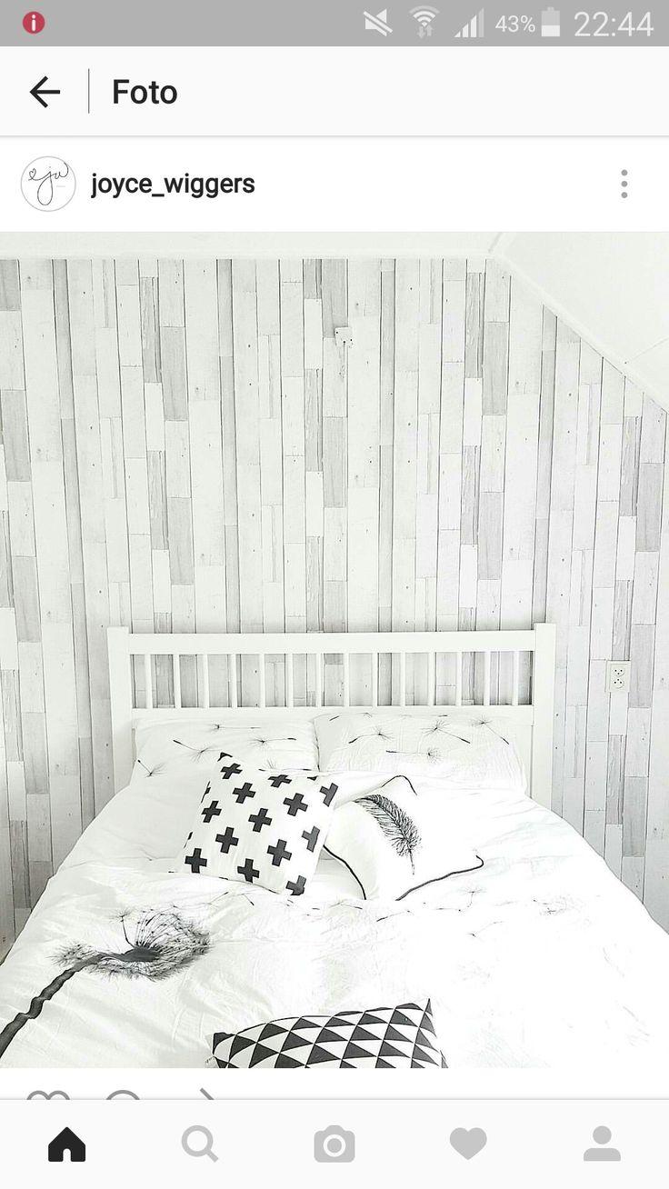 Behang achter hoofdeinde bed