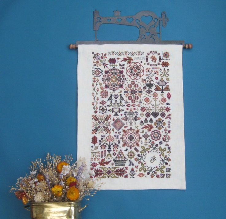 Autumn Quakers  by Rosewood Manor: see how to mount this cross stitch on a quilt hanger on Janet Granger's Blog