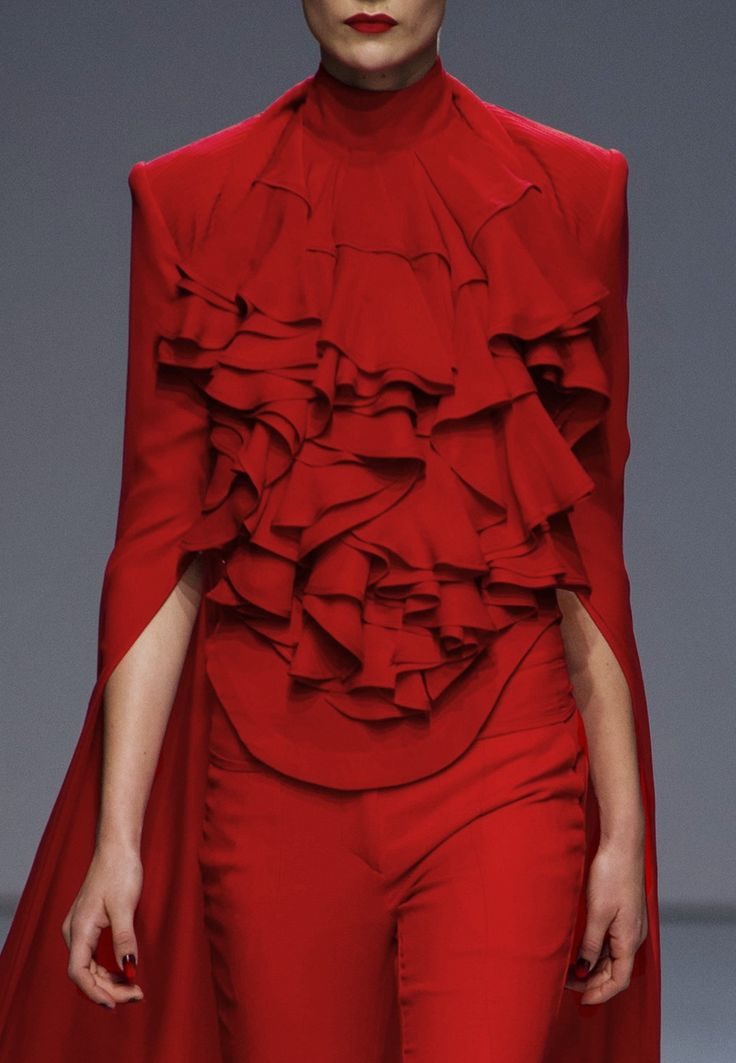 Gareth Pugh s/s 2013 True red is one of my favorite colors for spring colored types. It just radiates JOY! A vibrant color indeed.