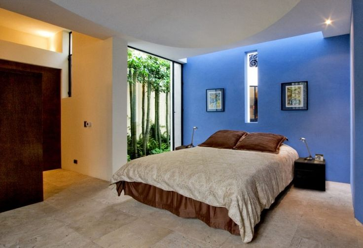 colors to paint your bedroom blue walls white ceiling lights bed pillows wall decors southwestern bedroom of Beautiful Colors to Paint Your Bedroom and Make It Look Charming