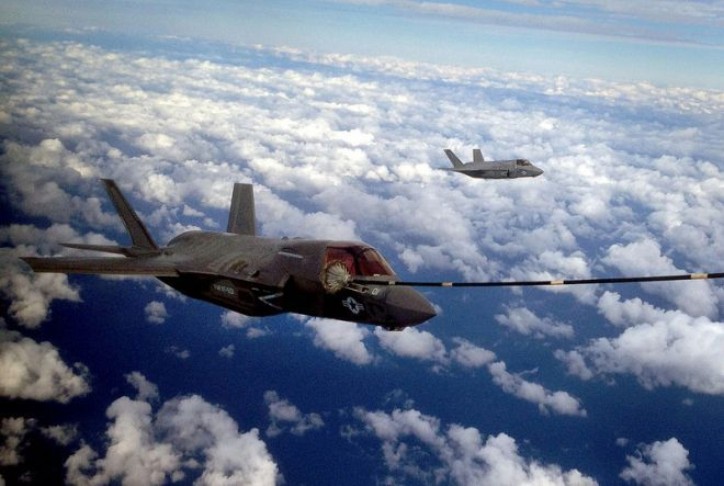 Two F-35B Joint Strike Fighters conduct the first aerial refueling of its kind with a KC-130J Hercules