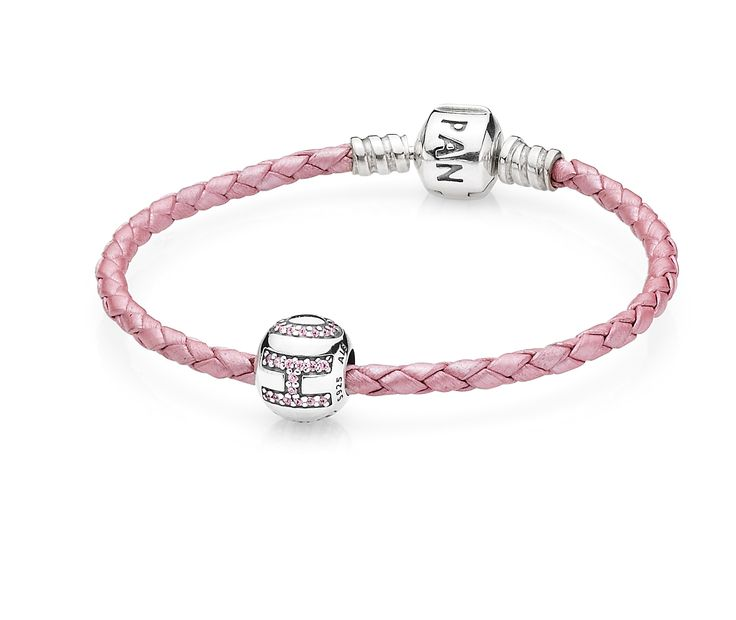 This year, PANDORA introduces a limited edition Pink Ribbon bracelet and charm set, featuring a pink braided leather bracelet with a sterling silver charm insert with delicate cubic zirconia letters to spell out the word 'HOPE'.