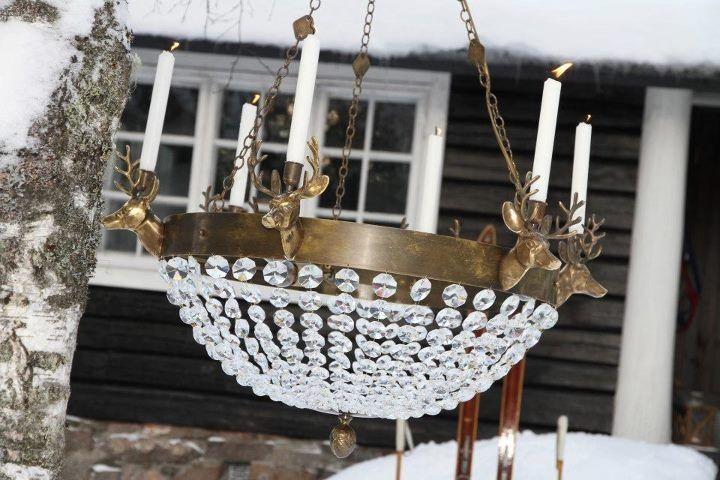 """Handmade chandelier in brass (antique) with reindeer, """"Stetind""""."""