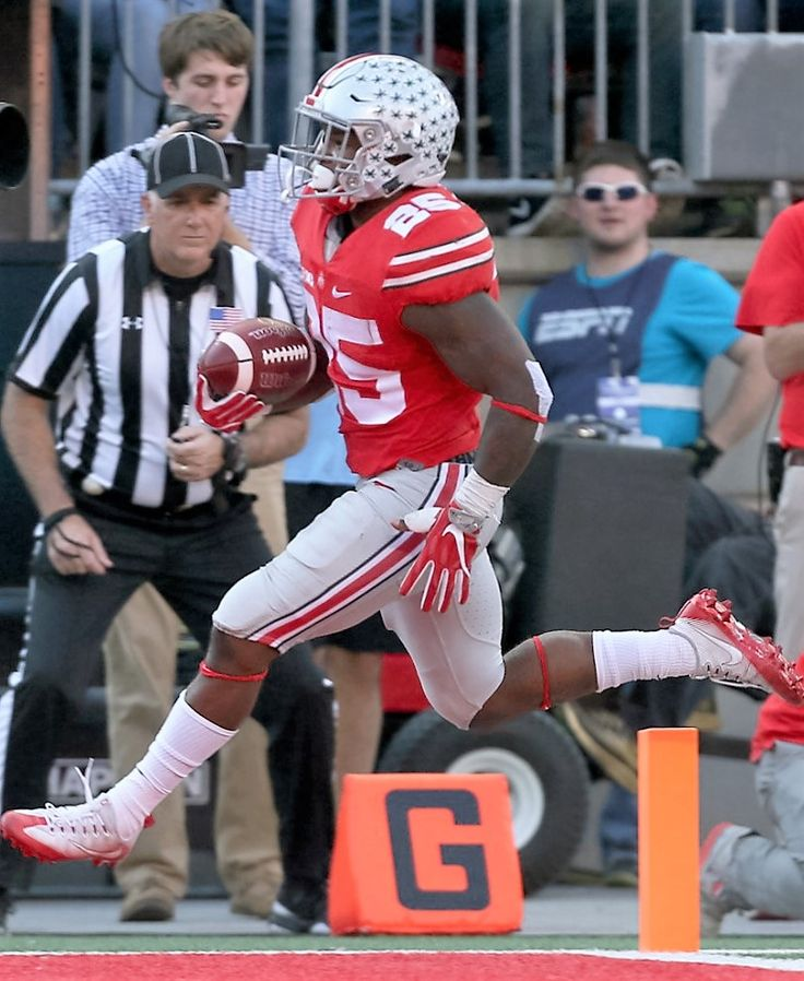 Ohio State Buckeyes running back Mike Weber (25) leaps over the goal line to score a second quarter touchdown against Northwestern,