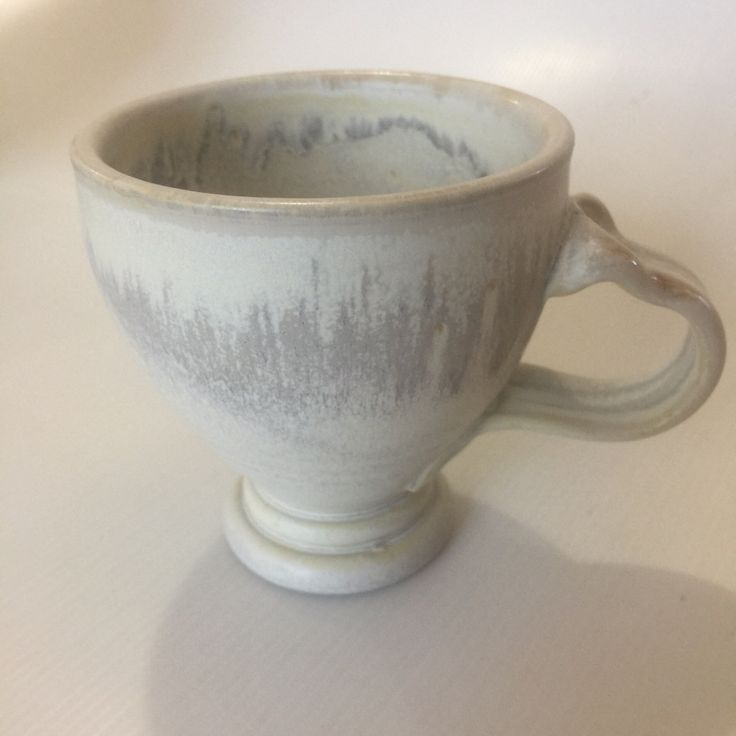 Pedestal mug — A more elegant mug with that well known thumb print for a comfortable fit - shown in a mottled cream glaze. Also available in Kim's other glazes. Please check out our website www.kimmorgan.co.nz #kimmorganpotterynz #beautifulmugs #coffeetime #teabreak #newzealand