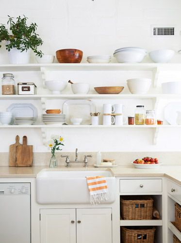 DIY kitchen - update a 40's or 50's kitchen w/ just a few deletions, a few additions + some paint. IKEA farm sink, remove lower cabinet doors/insert some shelves. Remove uppers/replace w/shelves - for a more country look, try spray painting boards w/one coat of white paint to let the grain show through. New counter? There's some amazing laminates + Armstrong makes an great solid surface that's less expensive than Corian. Voila! #kitchen #makeover #renovate #DIY #update