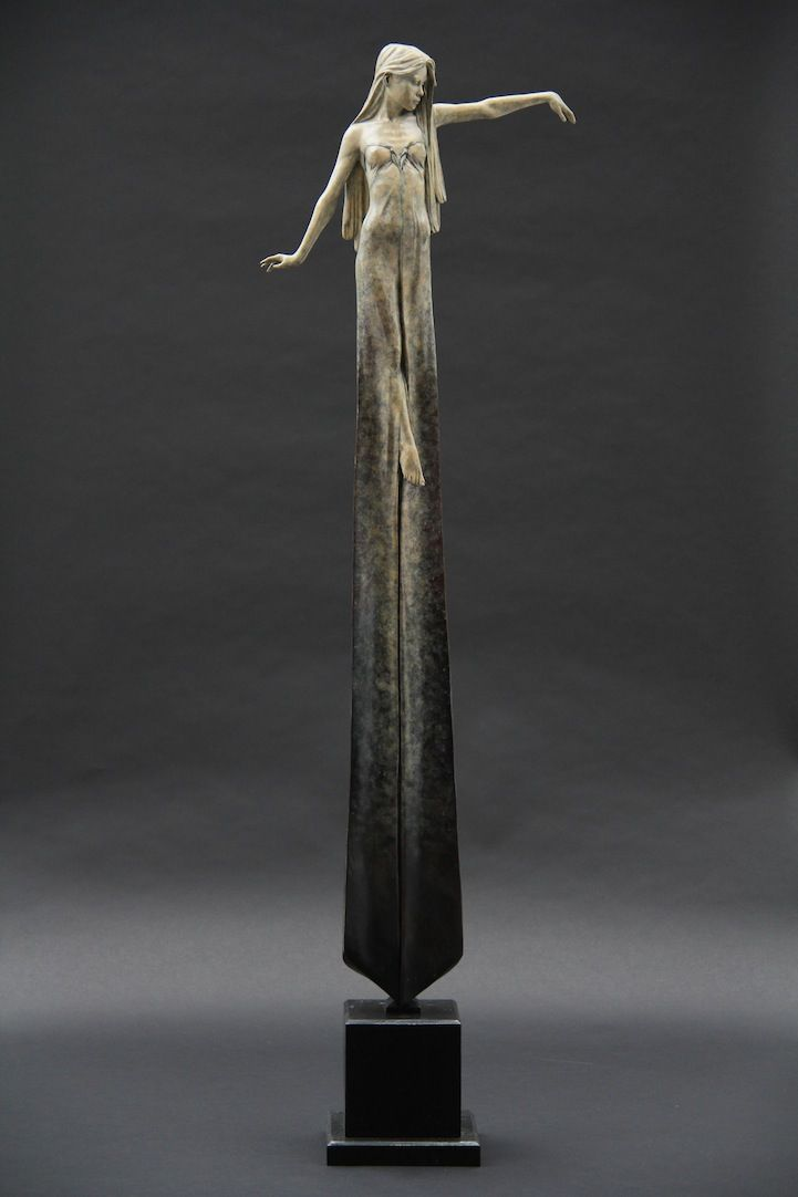 London-based artist Michael James Talbot creates beautiful sculptures of elongated women inspired by Greek mythology and Venetian masquerades. The surreal