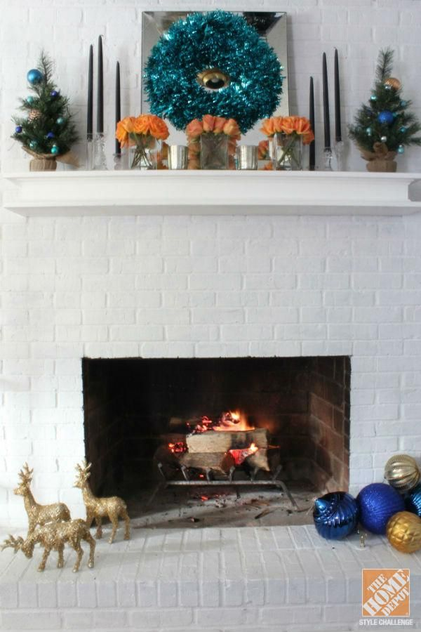A White Brick Fireplace Is The Perfect Backdrop For Holiday Decorations