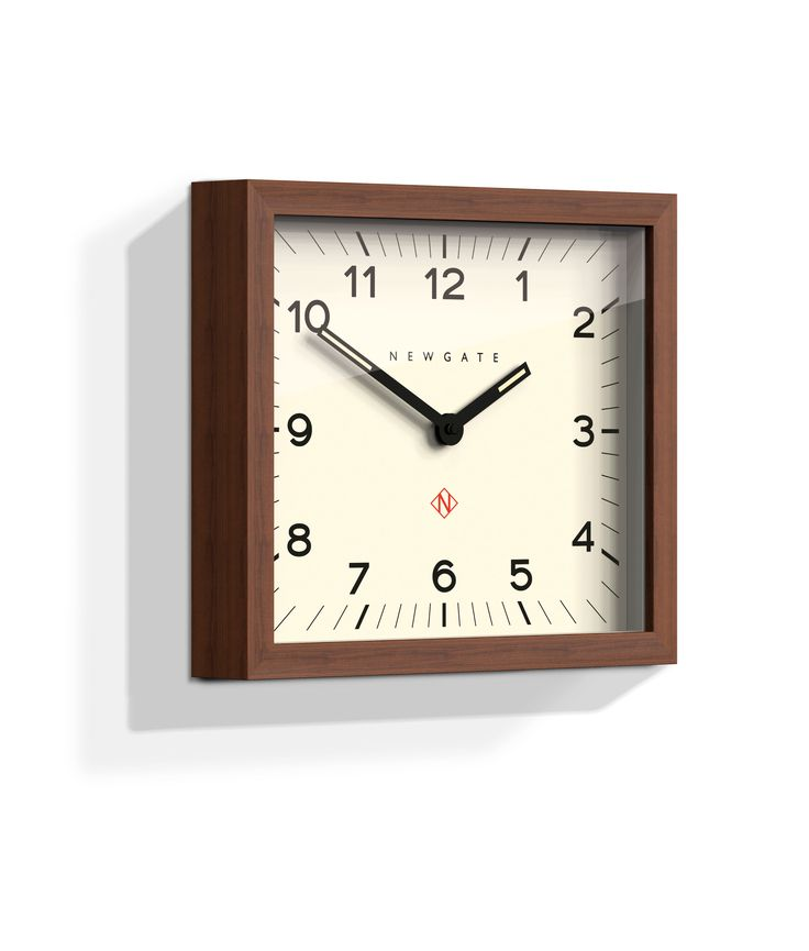 The dark wood Mr Davies wall clock is, at first glance, quite a serious clock with sensible, legible black numbers contrasted against a clean white face.