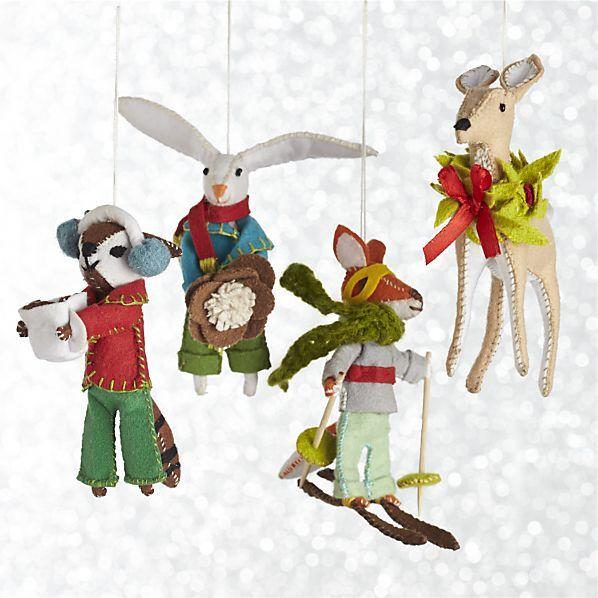 Capturing her fondness for small animals and miniature objects, Cynthia Treen's charming ornaments create a magical memory. Each charming animal is dressed for the season and ready for winter fun.