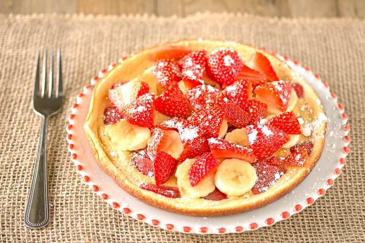 Honey cloud pancakes with fruit.  Light, eggy and sweet, they're the perfect cross between a pancake and a Dutch baby