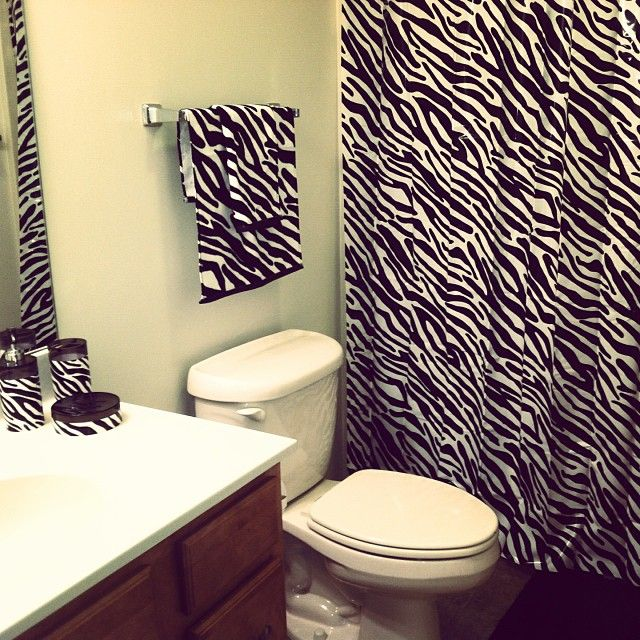 I have this same shower curtain, towels,etc. but my toilet has it on it too. I did the toilet in zebra duct tape. awesome