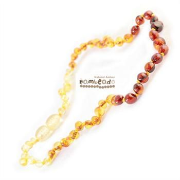 Wearing this amber necklace might assit your baby with teething or eczema.This premium amber necklace comes in a combination of Lemon,Cognac and Honey combination from lighter to darker. Amber beads are finished in a polish compared to the standard bud range. The amber necklace is approx 32-34cm in length. Bambeado amber is genuine baltic amber. Bambeado's are to be worn and not chewed. Each bead is individually knotted to help with safety. The Bambeado comes together with a plastic screw…