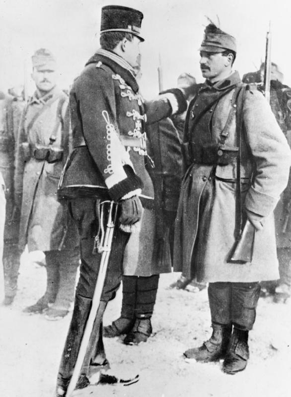 Archduke Charles Francis Joseph congratulates an Austrian soldier who has been recently decorated in 1914.
