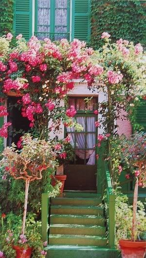 The house and garden of Claude Monet (Giverny/ France). I love the idea of framing the front entry with vines and flowers