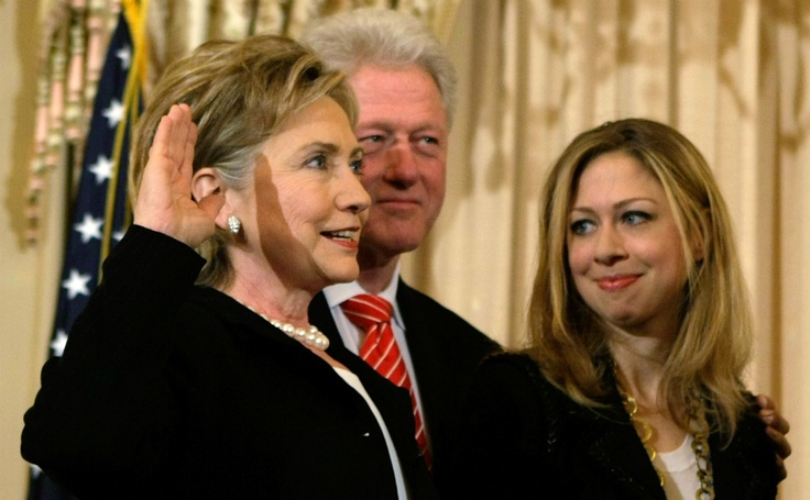 Clinton is sworn in as the 67th U.S. secretary of state in February 2009, while her husband, former President Bill Clinton, and her daughter, Chelsea, look on during a ceremony at the State Department