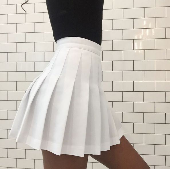 This pleated skirt takes us back to our high school cheerleading days!