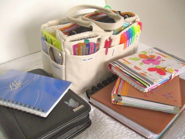A Palette Full of Blessings Journal supply bag. when I sit down to either work in my person journal or art journal or bible study journal I have my bag right beside me. It is compact and easy to move any were I choose to journal which is some times out side.