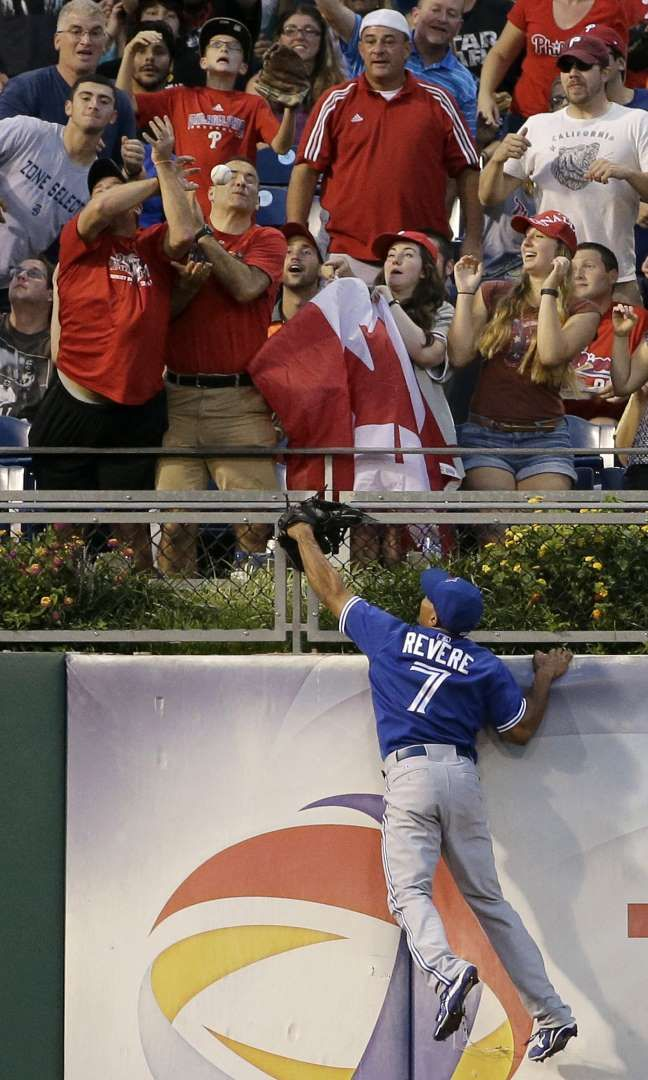 Into the stands - Toronto Blue Jays left fielder Ben Revere can't reach a home run by Philadelphia Phillies' Jeff Francoeur during the third inning of a baseball game on Aug. 19 in Philadelphia. - © Matt Slocum/AP Photo