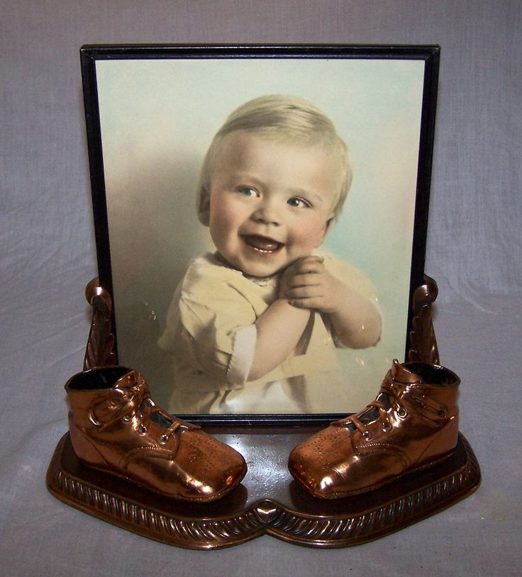 bronzed baby shoes and framed portrait