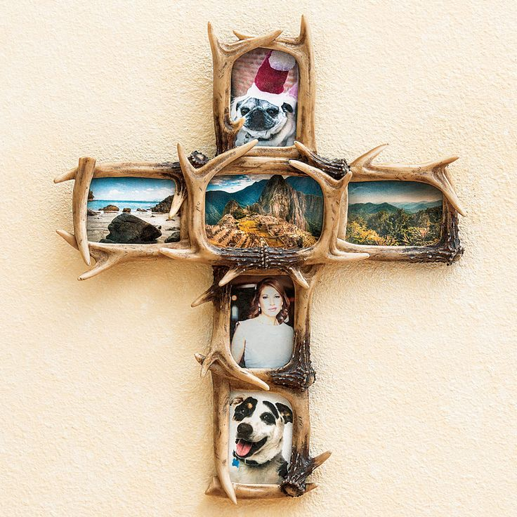 "A Camo Trading Exclusive - The Antler Cross Picture Frame features realistic polyresin faux antlers in a cross-shaped wall frame.  Holds one 4"" x 6"" photo and five 3½"" x 5"" photos.  Measures 19¼""W x 1¾""D x 23¼""H. ~"