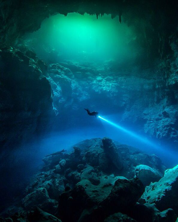 Cave Diving in Tulum, Mexico Photograph by Patrik Gustafsson, National Geographic Your Shot  A diver explores a cenote in Tulum, Mexico. Ancient Maya believed that the rain god Chaak lived in these natural wells. Now they are giving archaeologists new insights into the sacred landscapes of the ancestral people.