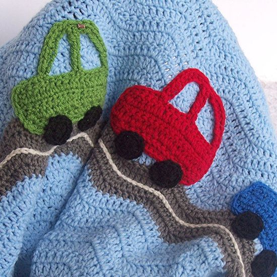 Puddin Toes Crochet Car Baby Blanket: A fun take on the traditional crocheted baby blanket, this one features soft acrylic knit cars on a windy road ($60).