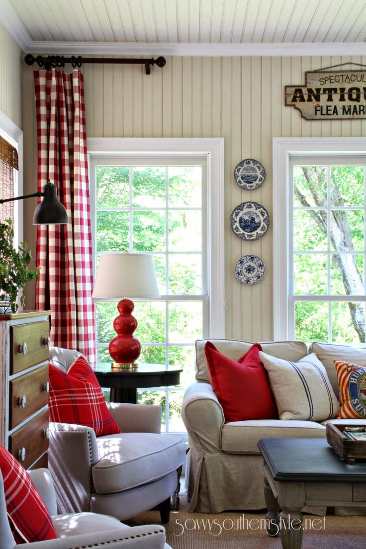 Savvy Southern Style: The Sun Room Spring 2014  I love the pops of red, especially the checked curtains.