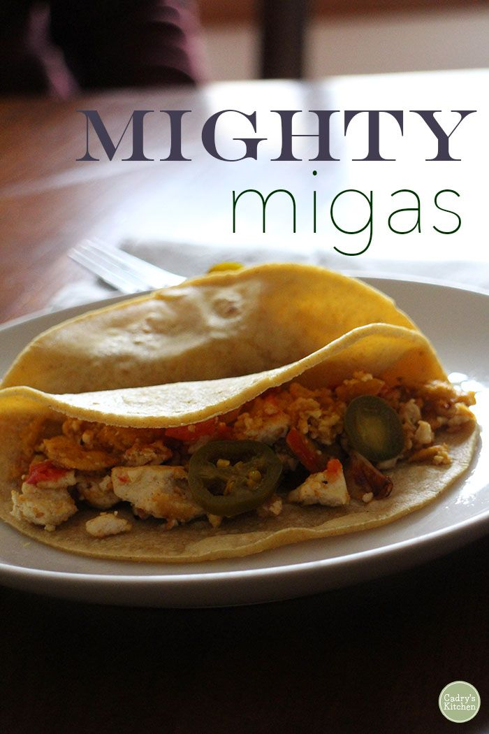 Get the day started right with this Mighty migas recipe from The Taco Cleanse. Crunchy tortilla chips, creamy vegan cheese, and tofu wrapped up in a tortilla.   While you're there, enter to win a copy of Taco Cleanse cookbook! | cadryskitchen.com #vegan