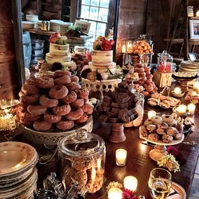 Rustic Wedding Dessert Table. Incorporate colorful flowers and lighting.  Caterer to make desserts Mini French Patesseries (3 vendors) Bakery to provide 2-tier cake for cutting ceremony rose cupcake tower