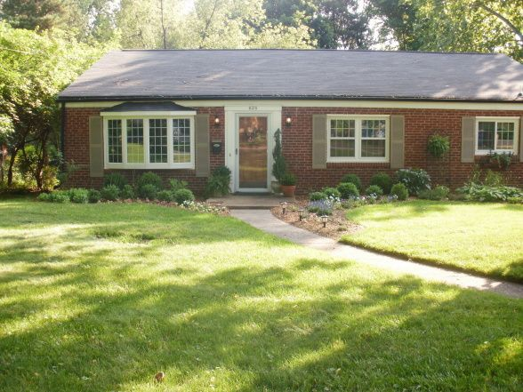 The Typical Red Brick Ranch With Grout Colored Shutters And White Trim Siding Matches Home Houses