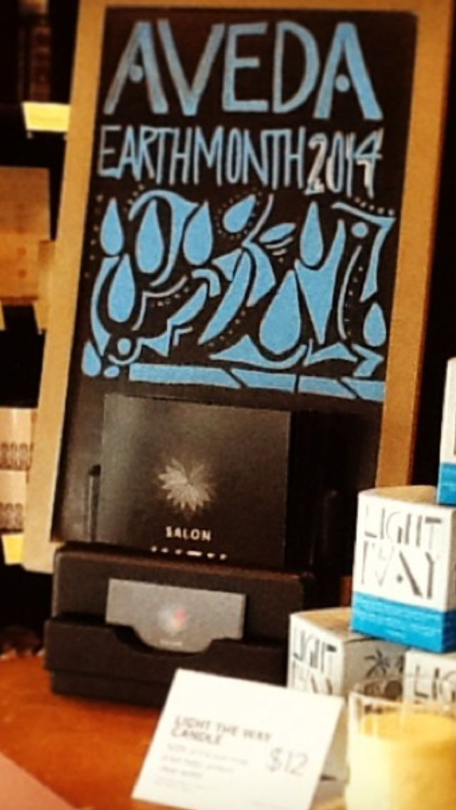 Our small chalkboard. Support Earth Month by Light The Way candles.
