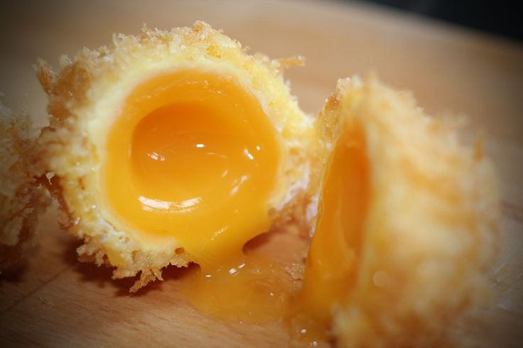 Fun with an egg yolk... Cooked sous vide style, breaded and deep fried.